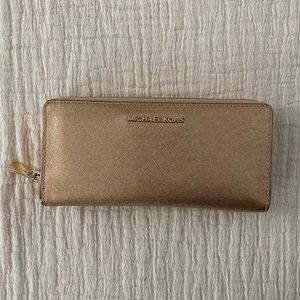 Michael Kors gold wallet/wristlet